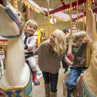 Family fun on the Carousel in the Seaside Carousel Mall