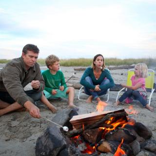 Family enjoying a beach campfire in Seaside Oregon